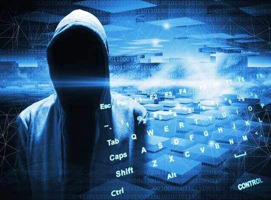 Hacker in a hood on dark blue digital background